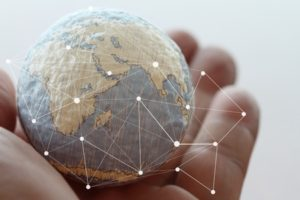 38155153 - close up of businessman hand showing texture the world with digital social media network diagram concept elements of this image furnished by nasa