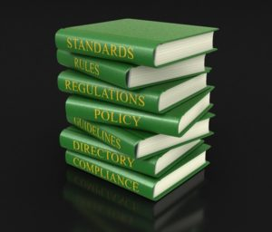 37717726 - stack of compliance and rules books