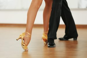 44514299 - beautiful womanish and masculine legs in active ballroom dance, indoors